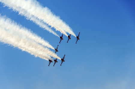 The Turkish Stars display team in a box formation going away from the camera