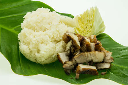 Close-up of grilled pork with sweet spicy sauce and sticky rice