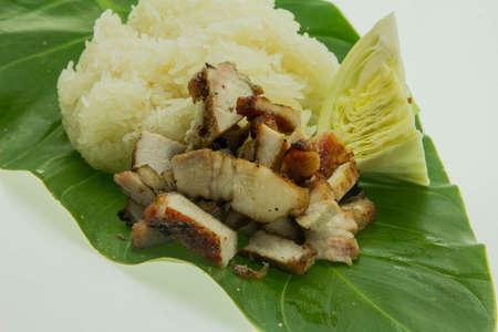Close-up of grilled pork with sweet spicy sauce and sticky rice photo