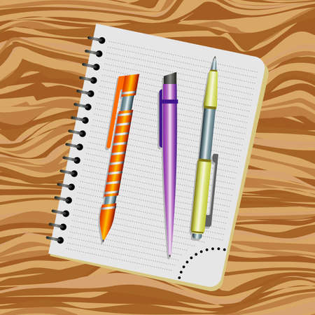 Notebook, orange pen, purple pen and yellow pen on a wooden table