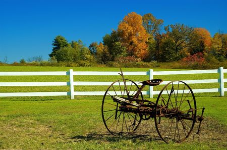 Photo of a old rustic wheel in the fall Stock Photo