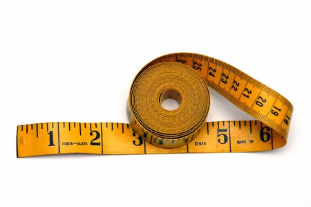 Landscape shot of a Measuring tape against a white background photo