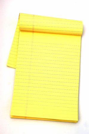 Yellow Note pad against a white background with a soft shadow