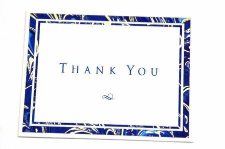 agradecimiento: Gracias tarjetas fotografiado sobre un fondo blanco  Foto de archivo