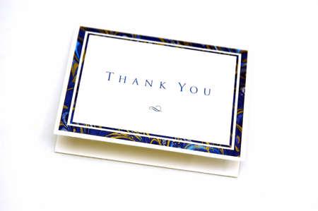 agradecimiento: Gracias de tarjetas de felicitaci�n en un fondo blanco Foto de archivo