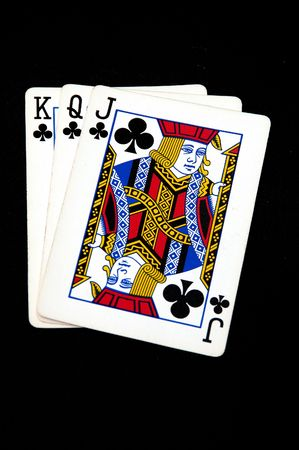 king and queen: King Queen and Jack of Clubs arranged on a black background Editorial