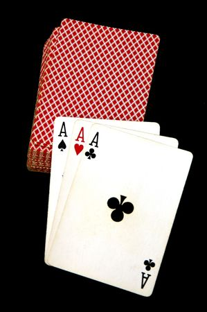 Three Aces with the card deck in a black background