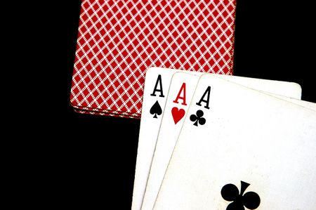 Three Aces, Clubs, Spade and Hearts against a black background