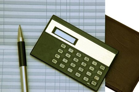Checkbook, Balance sheet pen and a calculator against a white background