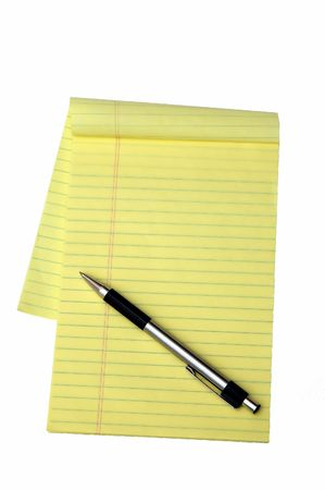 Yellow notepad and a pen isolated in a white background