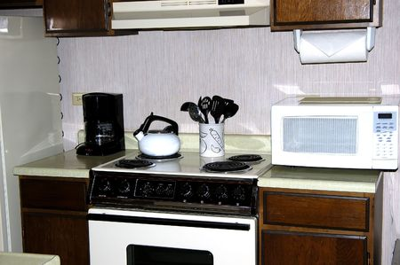 oven and range: A clean kitchen countertop on a rental condimonium