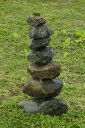 A set of stones stacked on the top of each other Imagens