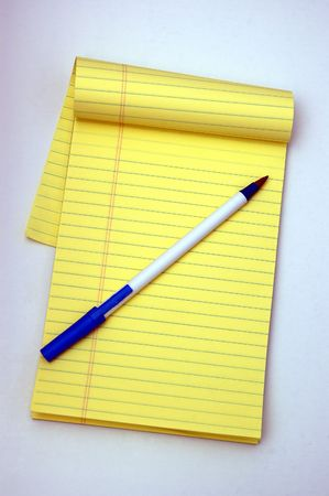A Notepad and a Pen against a white background