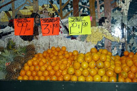 Fruits stall with price listing and some fruits Stock Photo - 680275