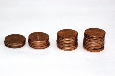 A series of coins places in increasing height to signify growth