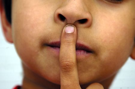 A kid placing his hands on his lips Stock Photo - 688804