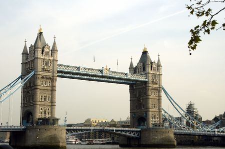 prespective: Famous Tower Bridge on a bright overcast day. Leaves giving the foreground prespective Stock Photo