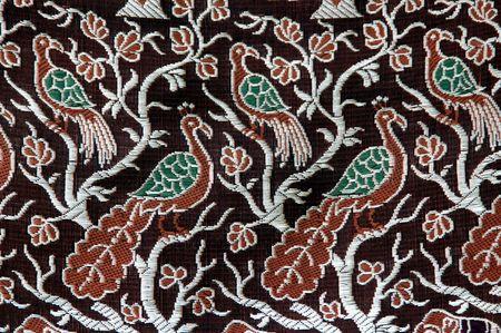 A peacock design in a fabric cloth photo