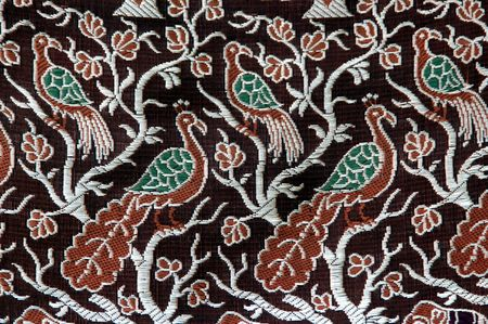 victorian wallpaper: A peacock design in a fabric cloth Stock Photo
