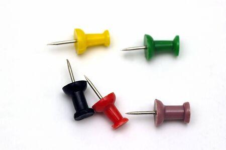 Colorful push pins against a soft background Banco de Imagens