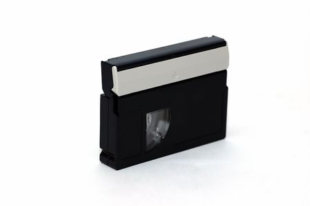 A mini DV tape isolated against a white background