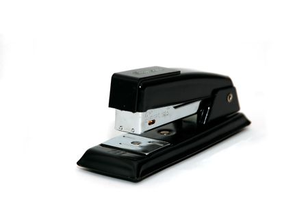 A Black stapler isolated against a white background photo