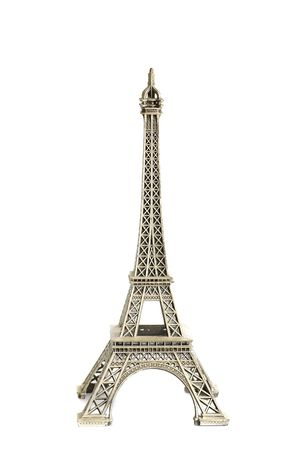 A replica of Eiffel tower isolated against  a white background