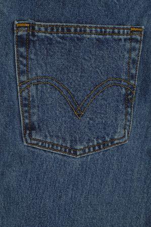 unbutton: A closeup shot of a denim pocket Stock Photo