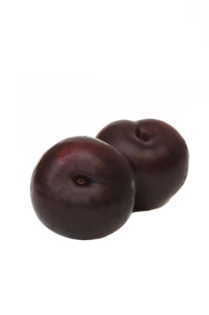 Two plums isolated against a white background photo