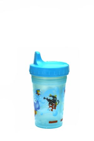 A Blue sippy cup isolated against a white background Stock Photo