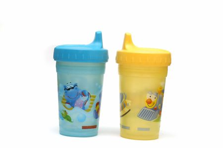 Two sippy cups isolated against a white background