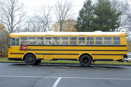 A School bus after dropping all children at school photo