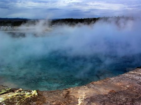 Hot Geyser in yellow stone on a summer day photo