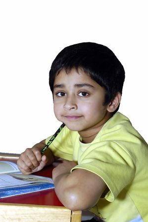 A kindergarden kid doing homework agains a white background Stock Photo - 754167