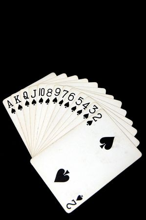 suite: Suite of spades against a black background