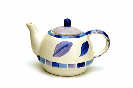 A Ceramic kettle isolated against a white background Stock Photo - 765777