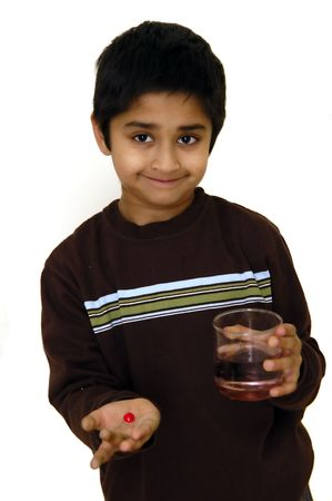 A kid isolated against a white background with a pill in his hand Stock Photo - 780898