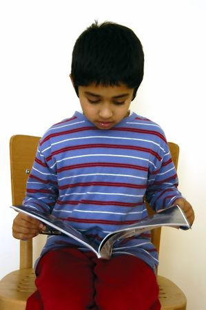 A handsome young kid reading a magazine Stock Photo - 780883