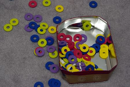 A pile of rings scattered on a carpet making a mess Stock Photo - 780865