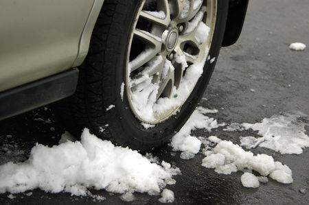 Car wheels driven on freshly laid ice Stock Photo
