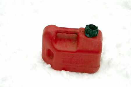 A Gasolene container isolated against a snow background photo