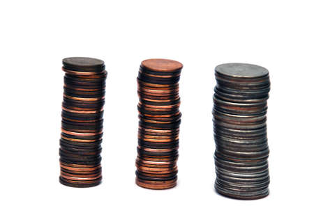 Piles of coins isolated on a white background