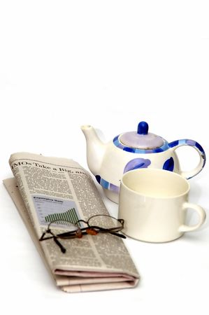 exceeds: A newspaper, coffee, glasses in a white background