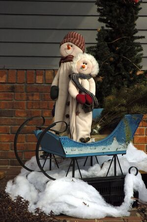snowwhite: Snowman on a sledge duing the cold winter