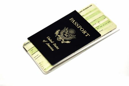 Passport and airline ticket isolated in a white background photo