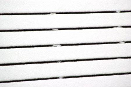 Closeup of a picnic table fully covered in snow photo