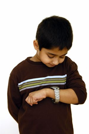A kid looking at his wrist watch