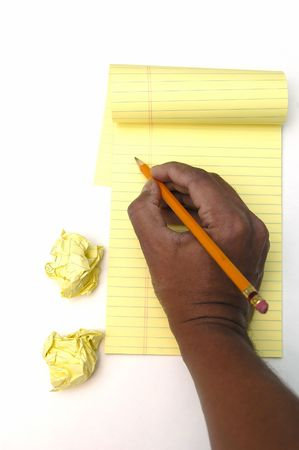 retry: Notepad, crushed paper, pencil and hand isolated on white Stock Photo