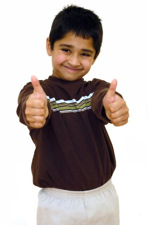 A young kid showing double thumbs up Stock Photo