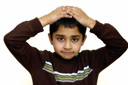 denoting: A child with hands on head denoting despair